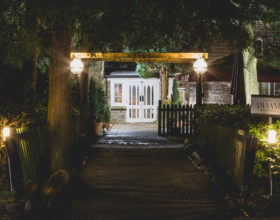 Path leading to the entrance of the restaurant at night.