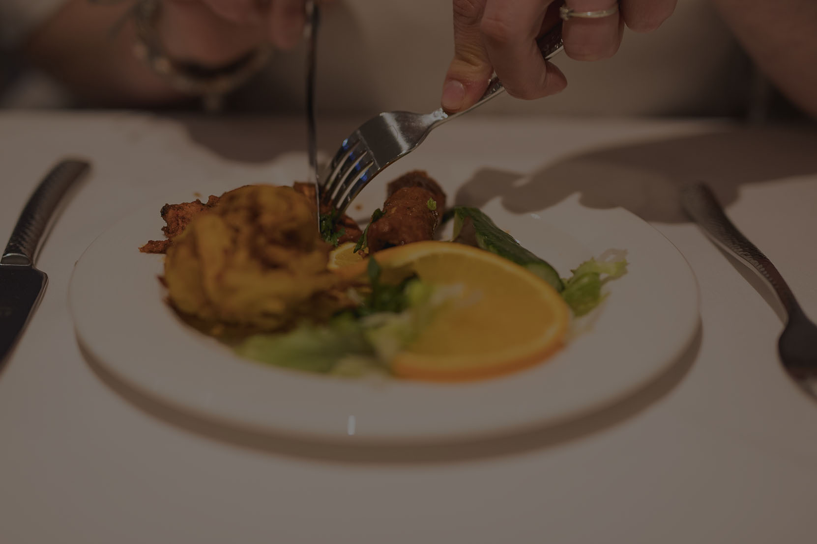 A person eating a starter at the restaurant.